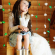 Stock Photo: Little girl in anticipation of Christmas night