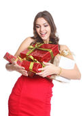 Happy brunette with boxed gifts in her hand — Stock Photo