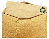 Brun gamla kuvert isolerad på vitt för återvinna koncept — Stockfoto