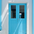 Blue door white plastered wall — Stock Photo