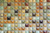Brown mosaic tiles background texture — Stockfoto