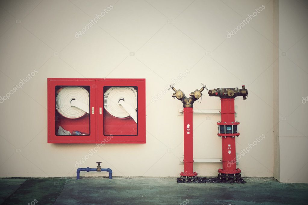 Vintage Hydrant with water hoses and fire extinguish equipment — Stock Photo #11873323