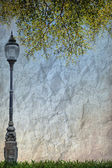 Lamp Street Road Light Pole and Green leave on old grunge paper — Stock Photo