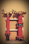 Hydrant with water hoses and fire extinguish equipment — Stock Photo