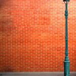 Lamp post street on brick wall background — Stock Photo