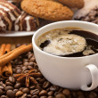 Stock Photo: Coffee cup, sweets, cinnamon, anise on coffee beans