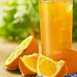 Постер, плакат: Orange juice on the table