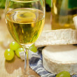 Stock Photo: White wine, Brie, Camembert and grape on the table
