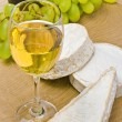White wine, Brie, Camembert and grape on the table — Stock Photo