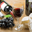 Stock Photo: Red wine, Brie, Camembert and grape on the table