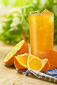 Orange juice on the table — Stock Photo