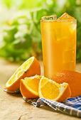 Orange juice on the table — Stock Photo