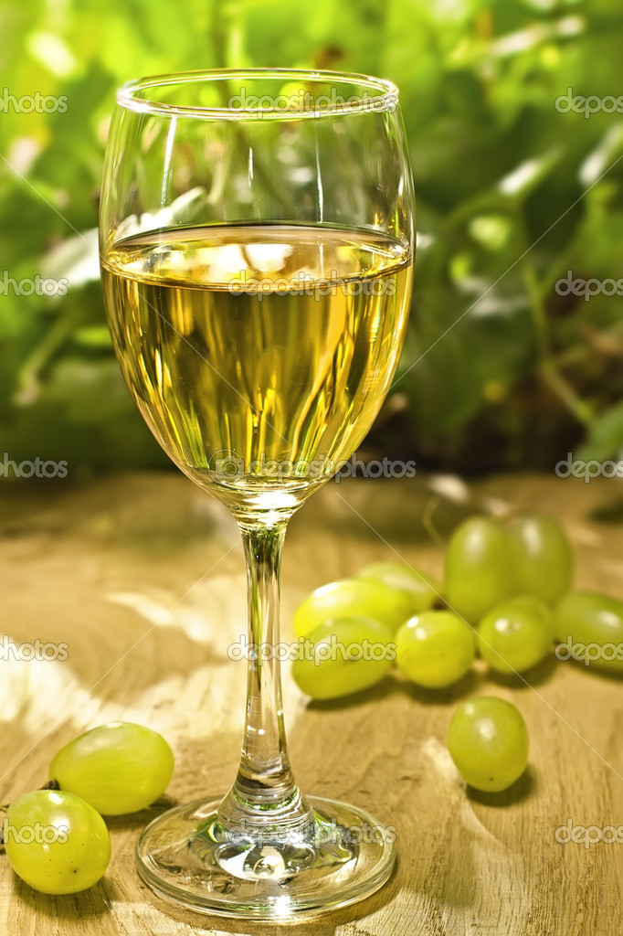 White wine glass on the wood surface, outdoor shot — Stock Photo #10933814