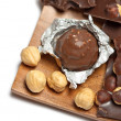 Chocolate bar and candy with hazelnut, — Stock Photo
