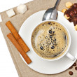 Stock Photo: Coffee cup, chocolate, hazelnut, beans, sugar and cinnamon