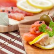 Stock Photo: Salmon snack on wooden plate