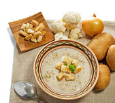 Cream soup with crusts and ingredients — Stock Photo