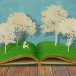 Paper cut of children read a book under tree on old book — Stock Photo #10762306