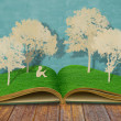 Paper cut of children read book under tree on old book — Stock Photo #10762306
