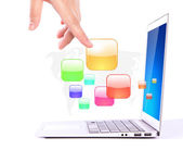 Female hands writing on laptop with colorful application icons — Stock Photo