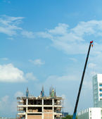 Construction crane and building — Stock Photo