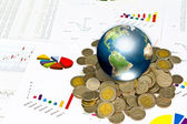 Coins and business graph with earth (Elements of this image fur — Stock Photo
