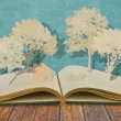 Paper cut of family symbol on old book ( House,Tree,Mom,Dad,Chi — Stock Photo