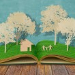 Stock Photo: Paper cut of family symbol on old grass book ( House,Tree,Mom,D