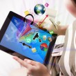 Stock Photo: Womreading touch screen device (Elements of this image fu