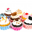 Stock Photo: Cupcakes isolated on white background