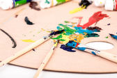 Wooden art palette with paint — Stock Photo
