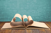 Book with opened pages of shape of heart — Stock Photo