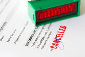 Cancelled letter rubber stamp on application form — Stock Photo