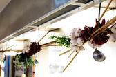 Onion an garlic braid hanged in kitchen — Stock Photo