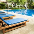 Swimming pool with relaxing seats — Stock Photo