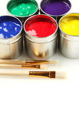 Cans of paint with paintbrushes — Stock Photo