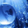 Earth & fiber optics — Stock Photo