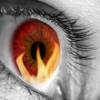 Red eye refecting fire — Stock Photo