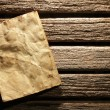 Royalty-Free Stock Photo: Old paper on wooden wall