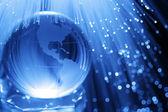 Earth & fiber optics — Stock Photo
