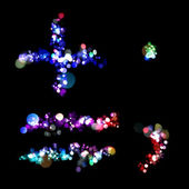 Lights in the shape of a plus, equals, period, and comma — Foto Stock