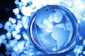 Glass globe in lights — Stock Photo
