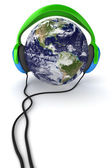 Earth & headphones — Stock Photo
