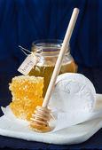 Cheese and honey. — Stock Photo