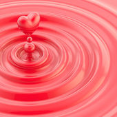 Heart shaped glossy liquid drop — Stock Photo