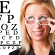 Wondering Businesswoman Looking at an eyechart — Foto Stock