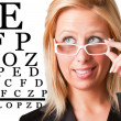 Wondering Businesswoman Looking at an eyechart — Stockfoto