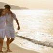 Happy young couple together on the beach — Stock Photo #12129173