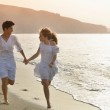 Happy young couple together on the beach — Stock Photo #12129175