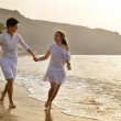 Happy young couple together on the beach — Stock Photo #12129365